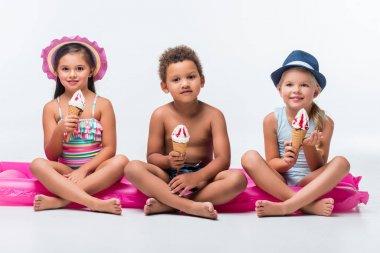 multiethnic kids eating ice cream