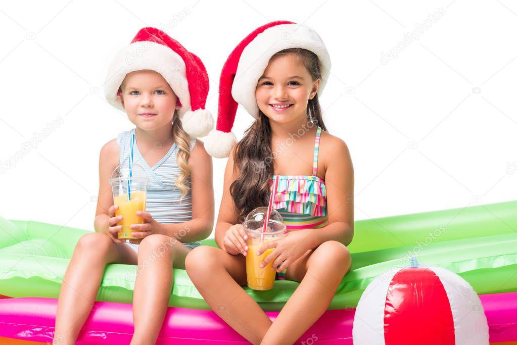 kids in santa hats with orange juice