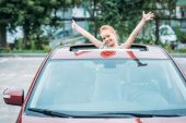 girl peering out of sun roof