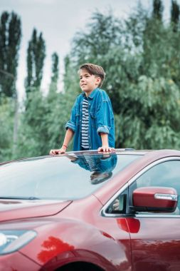 Boy peering out of sun roof