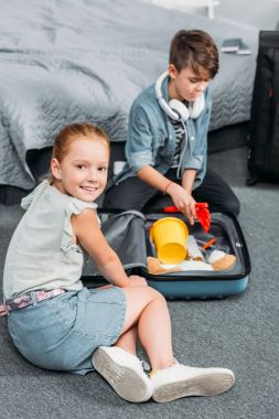 kids packing clothes for trip