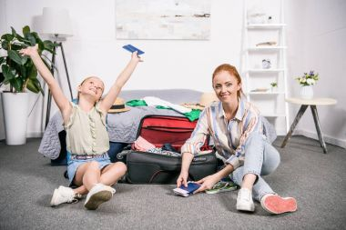 mother and daughter with luggage for trip
