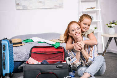 mother and daughter packing for trip