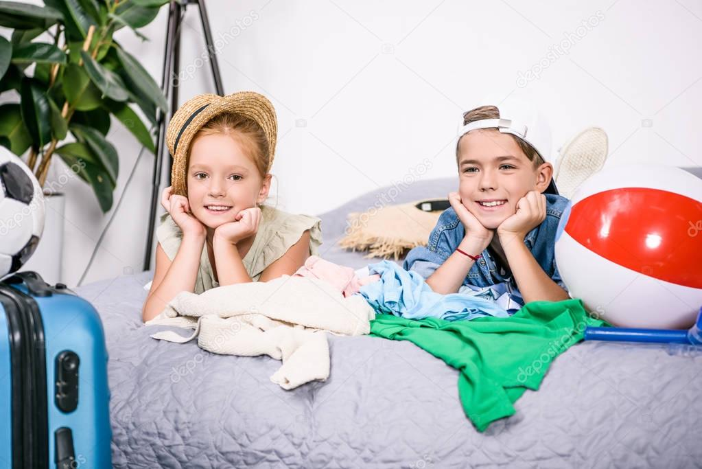 kids with clothes for trip