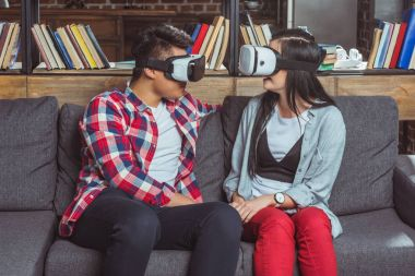 couple using vr headsets