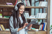 girl in headphones with digital tablet
