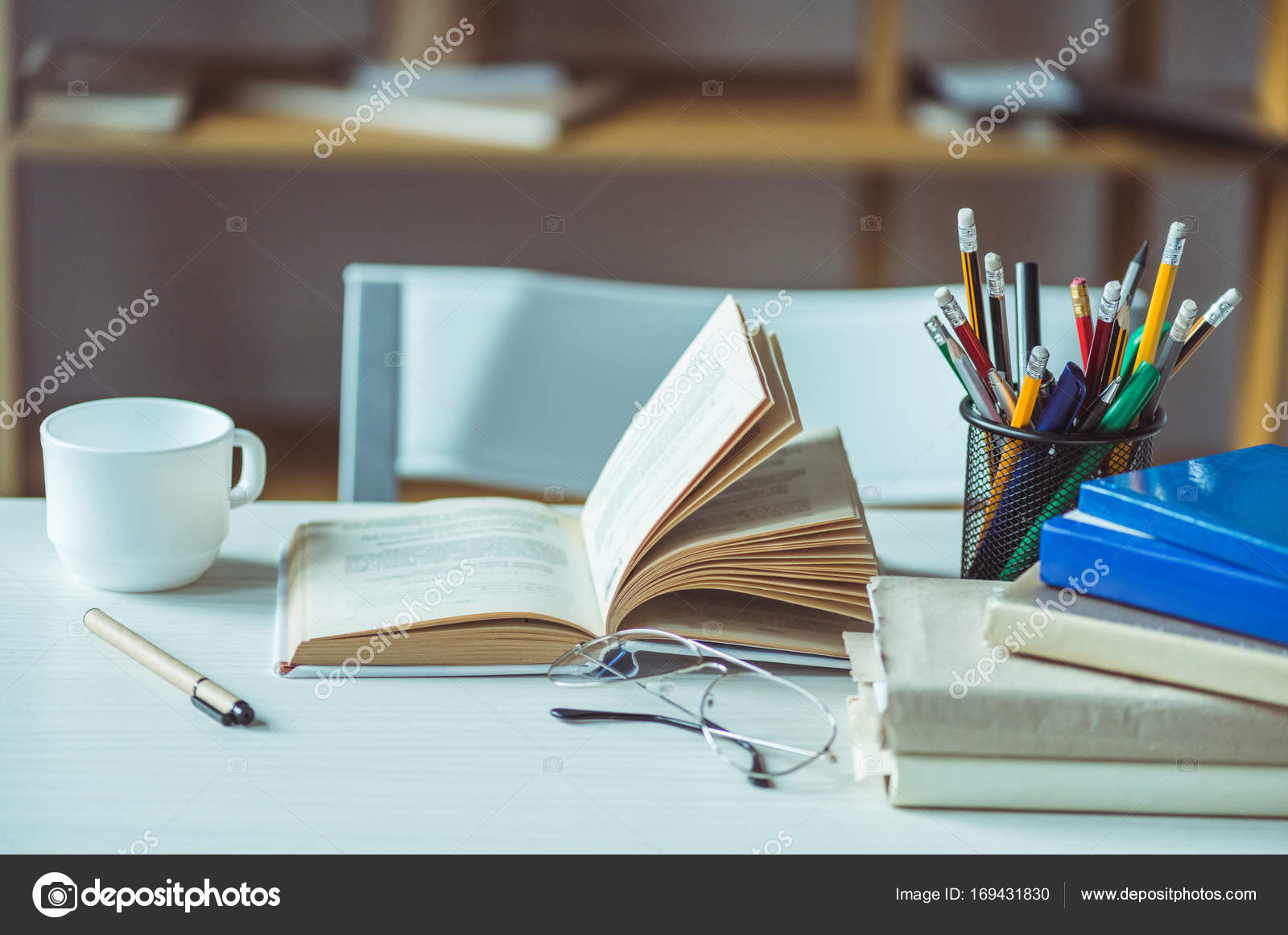 Books and coffee on table stock photo alebloshka 169431830 books and coffee on table stock photo 169431830 geotapseo Gallery
