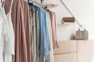 Rack with clothes in store