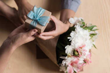 Man presenting gift to woman