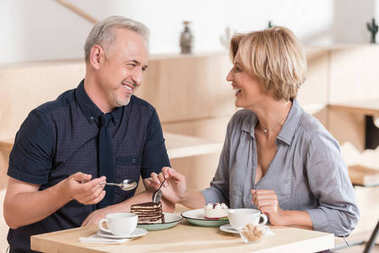 Lovely Couple eating sweets at cafe stock vector