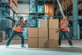 Photo warehouse workers moving boxes