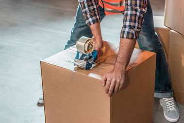 warehouse worker packing box