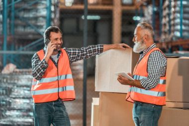 warehouse workers with digital devices