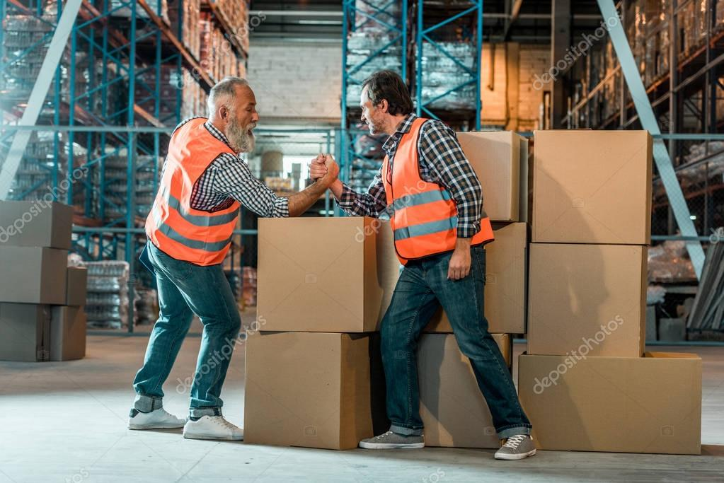 arm wrestling of warehouse workers