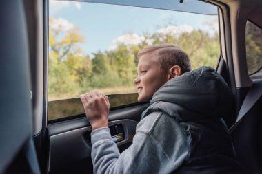 happy little boy in car