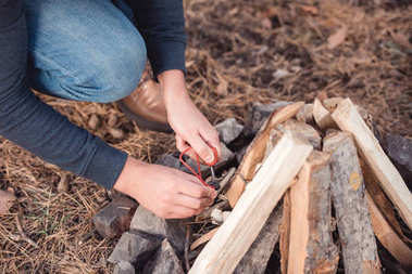 man kindling bonfire