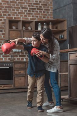 Mother and son practice boxing