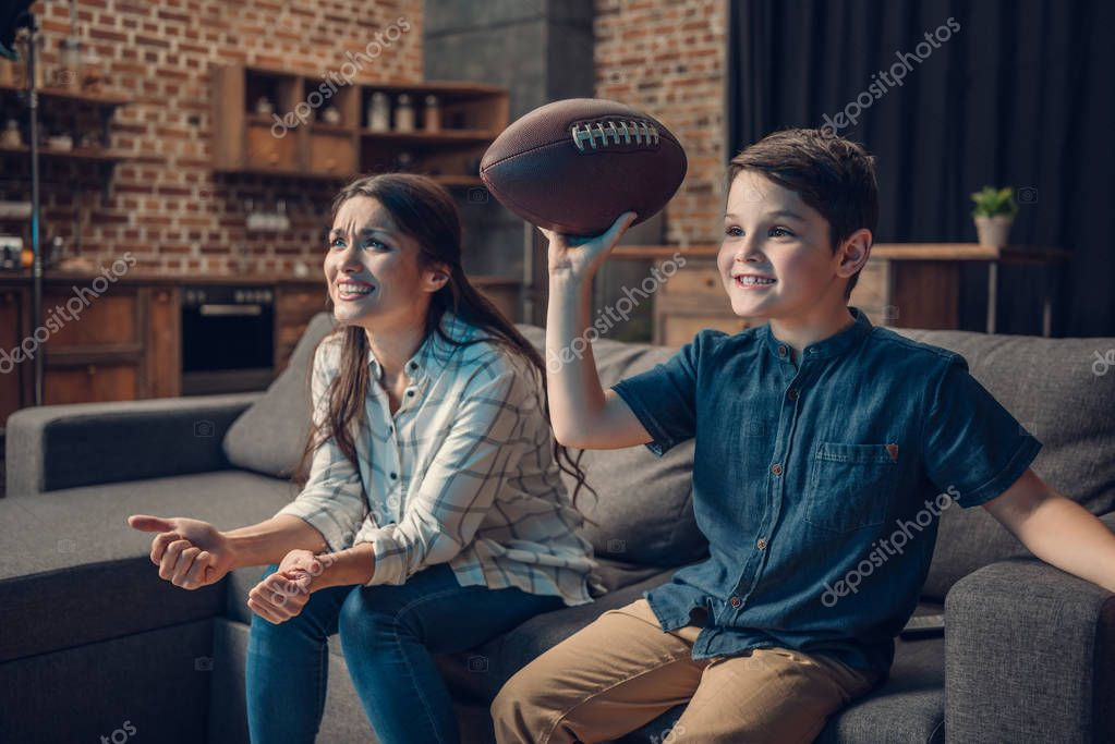 Cheering family watching american football