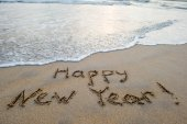 Fotografie happy new year sign on beach