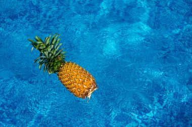 pineapple floating in water