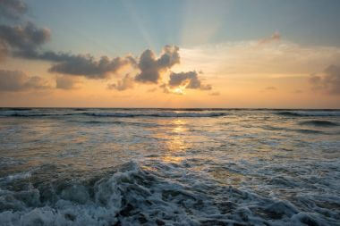 Beautiful sunset over wavy sea at sri lanka stock vector