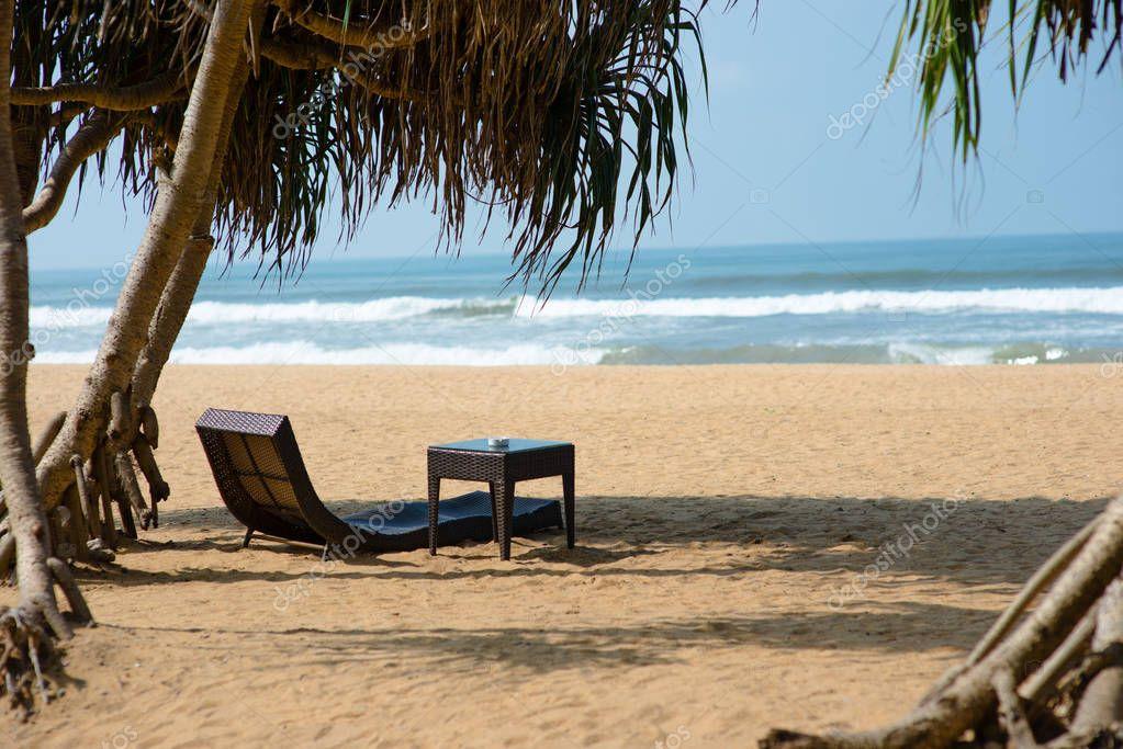 sunbed on sandy beach
