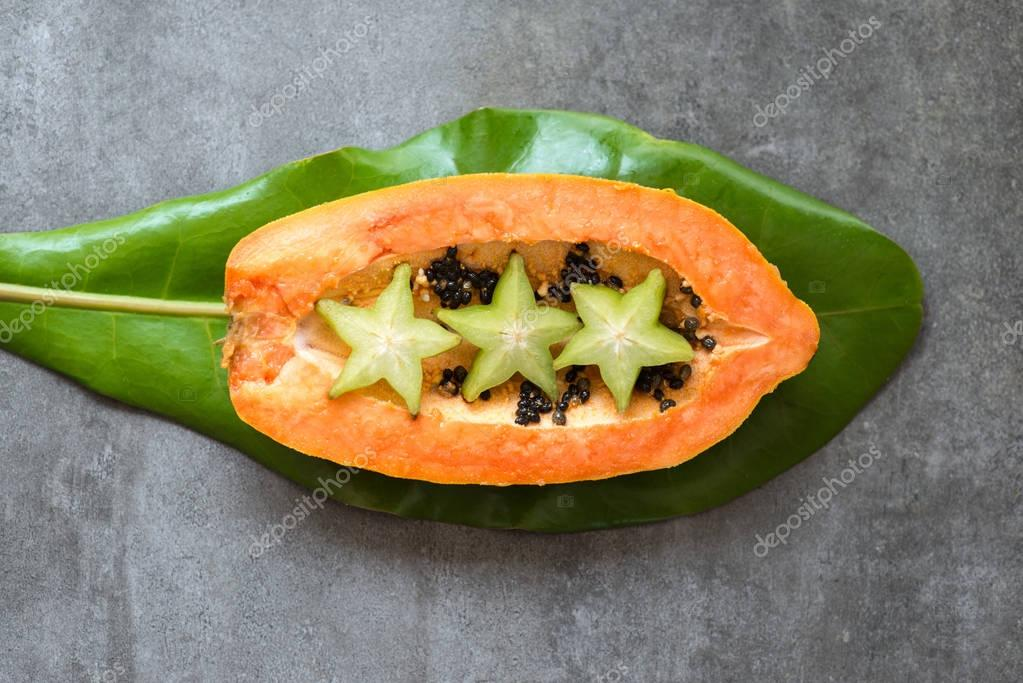 carambole and papaya fruits composition