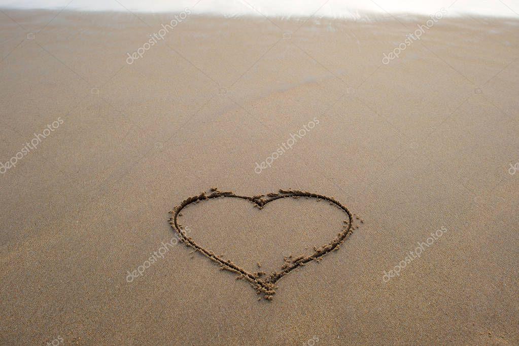 heart shape sign on sand