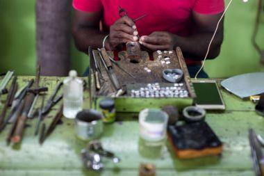 jeweler making rings