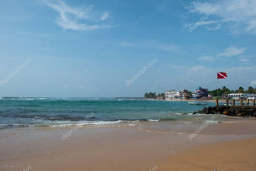 seashore with houses over water