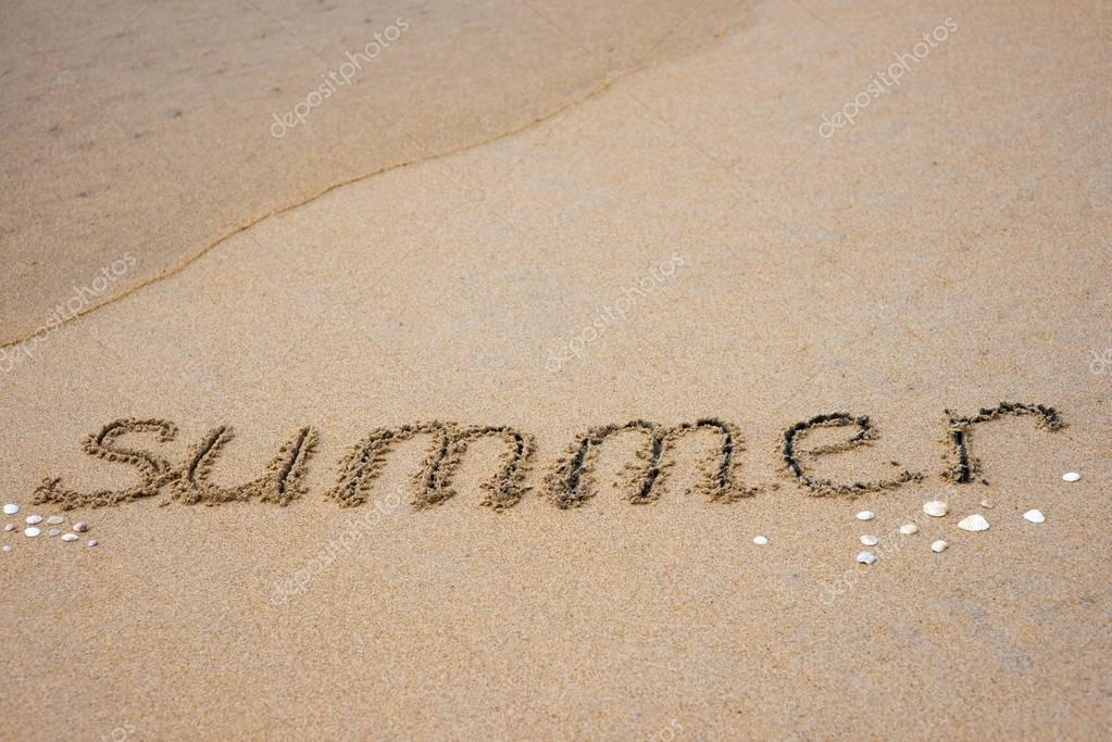 summer inscription on sand