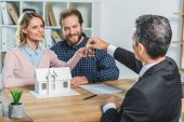 Photo couple getting keys from realtor
