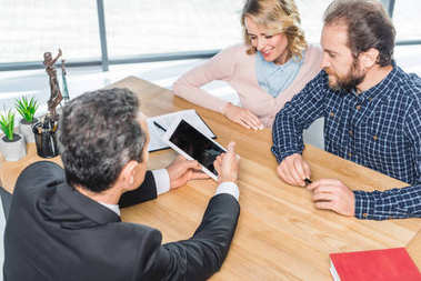 couple having meeting with lawyer