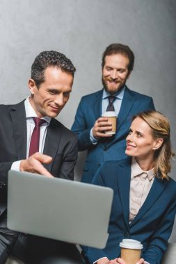 colleagues using laptop together