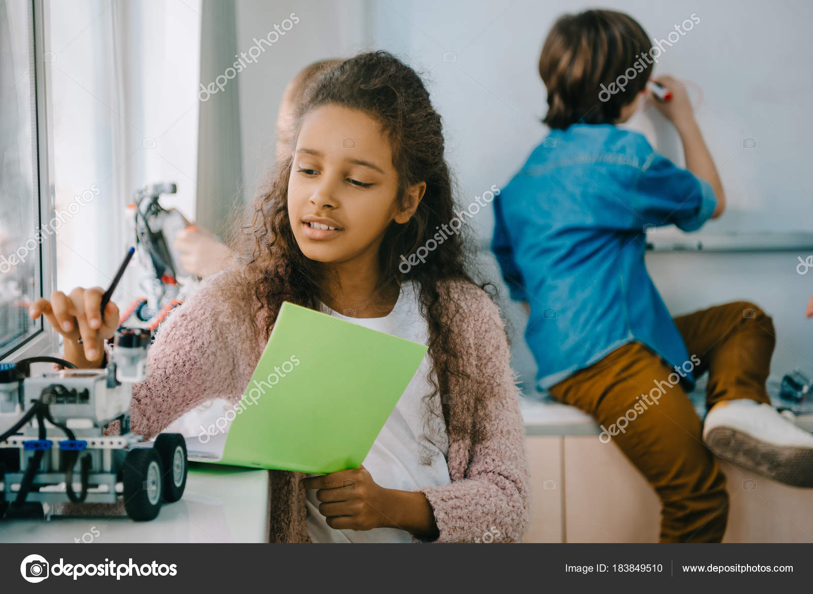 teen african american schoolgirl with notebook on stem education class