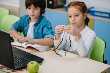 kids constructing project together, stem education concept