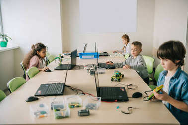 teen kids working on projects at stem education class