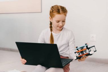 concentrated little child programming diy robot, stem education concept