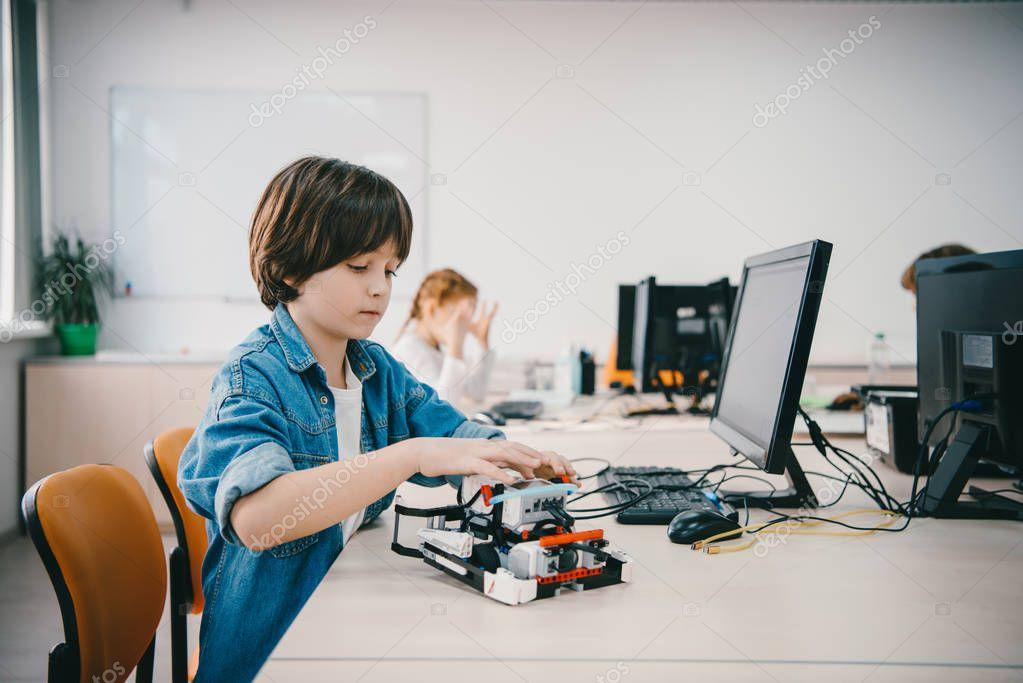 teen kid programming diy robot at machinery class