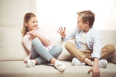 Cheerful siblings talking