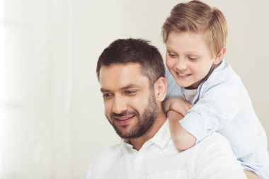 Son with father spending time at home