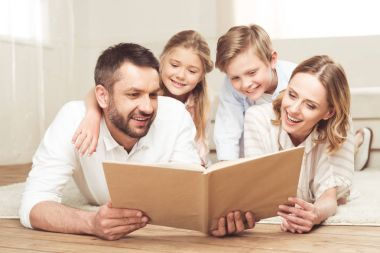 smiling family reading book