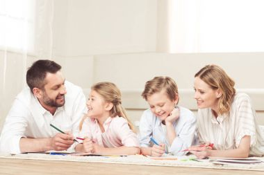 Happy family drawing pictures at home