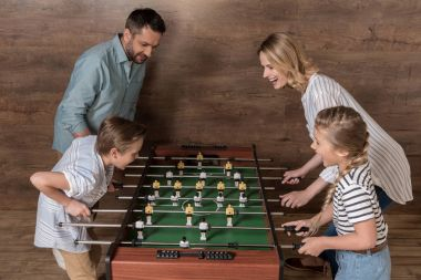 family playing foosball together