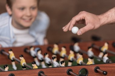 boy playing table football
