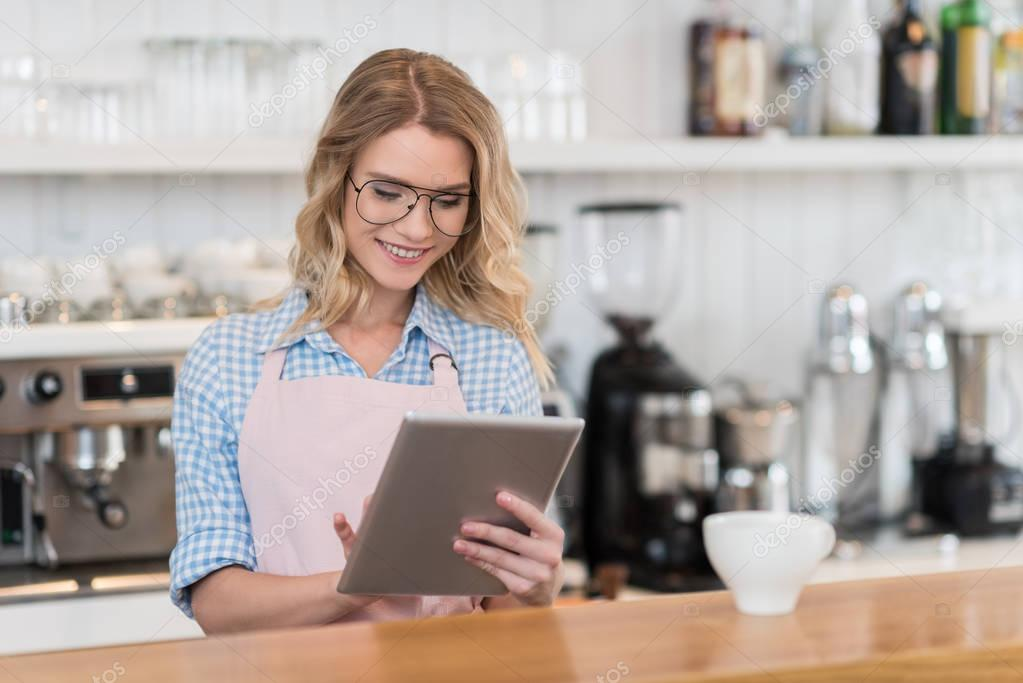 waitress with tablet in cafe