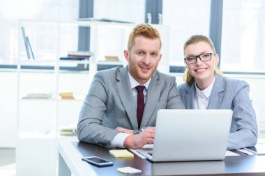 Businesspeople working with laptop