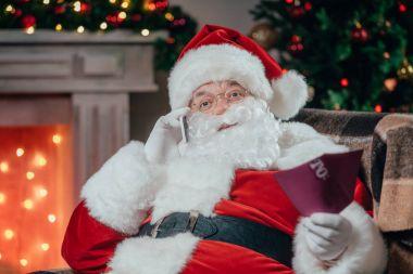 santa talking on smartphone