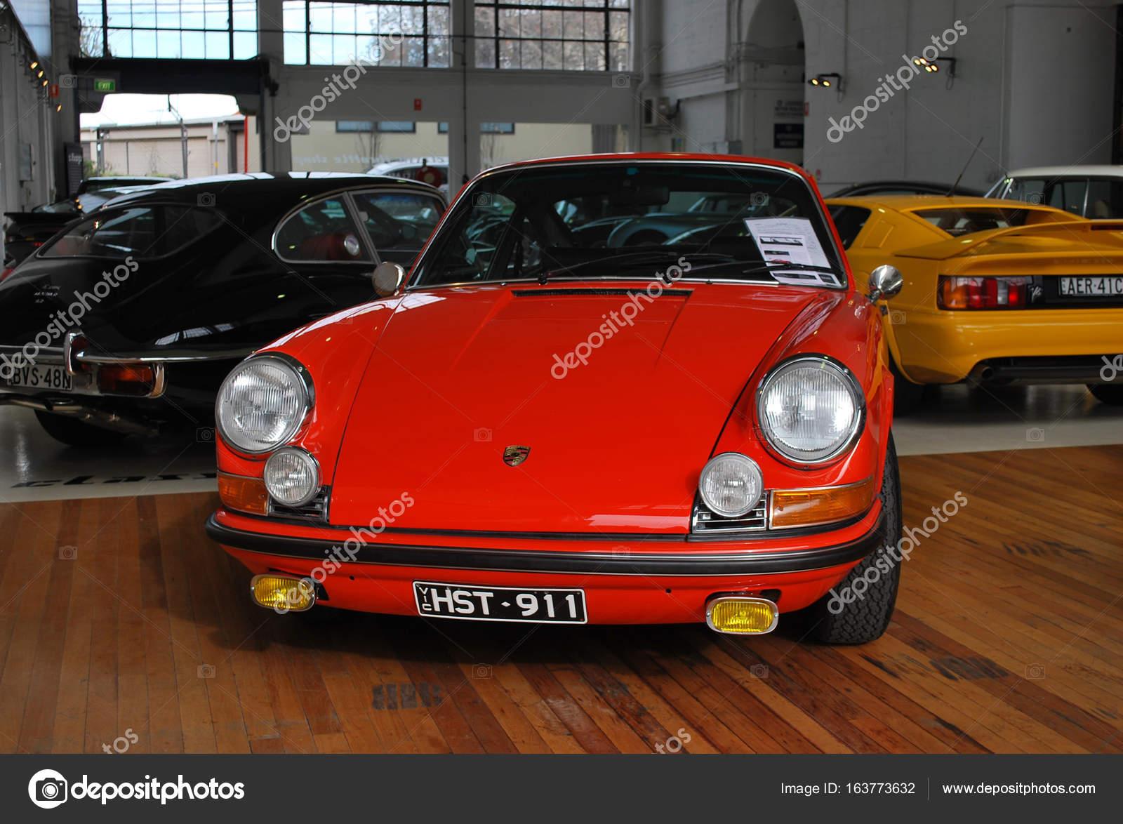 Fire red Porsche 911 Carrera car, old classic retro model on display ...