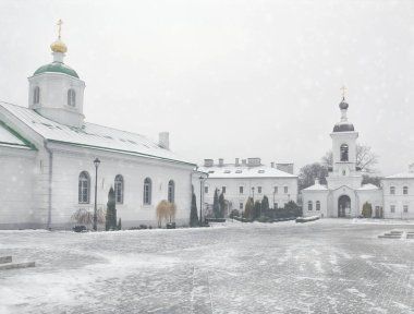 The City Of Polotsk Belarus. This courtyard of the Spaso - Efrosinyevsky monastery, with bell tower in winter during a snowfall.